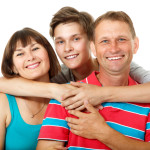 Mother, father with son teenager. Happy caucasian family having