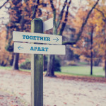 Rustic wooden sign with the words Together- Apart