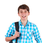 Ready to study. Handsome teenager carrying backpack on one shoulder and smiling isolated on white background