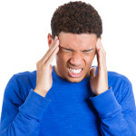 Young stressed man having bad headache, migraine